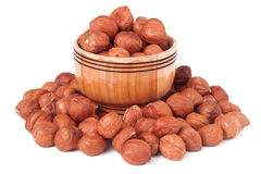 Peeled hazelnuts in a wooden bowl on  white background Royalty Free Stock Image