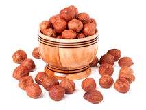 Peeled hazelnuts in a wooden bowl on  white background Stock Photography