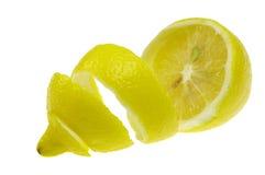 Peeled lemon. Half peeled lemon on white background Royalty Free Stock Photos