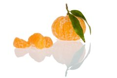 Peeled mandarin. With leaves, isolated on a white background Stock Photo