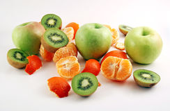 Peeled mandarin, apples and kiwies Royalty Free Stock Photo