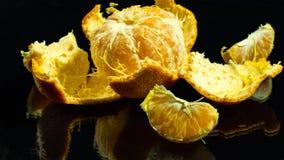 Peeled Mandarin on black background stock image