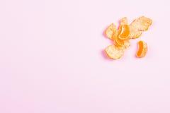Peeled mandarin on pink background Stock Photo