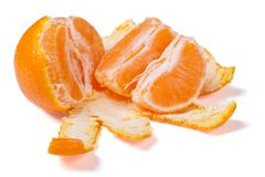 Peeled mandarin segments isolated on white background. Royalty Free Stock Photo