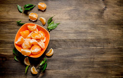 Peeled mandarins in the bowl with the leaves . Stock Image