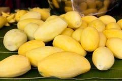 Peeled mango at street market Royalty Free Stock Images