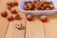 Peeled nuts in ceramic ware Royalty Free Stock Photos