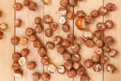 Peeled nuts on wooden boards Royalty Free Stock Photo