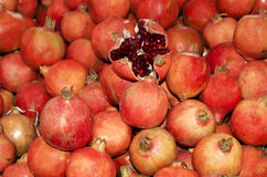 Peeled off Pomegranate. Bunch of Pomegranate. One Pomegranate is peeled off Royalty Free Stock Images