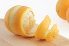 Peeled orange. Orange peeled fruit citrus isolated spiral curl Stock Photo