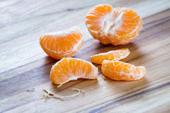 Peeled orange on a cutting board Stock Image