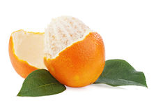 Peeled orange fruit with green leaves isolated on white backgrou Royalty Free Stock Photos