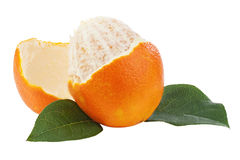 Peeled orange fruit with green leaves isolated on white backgrou Stock Photos