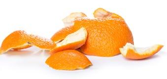 Peeled orange and its skin Royalty Free Stock Images