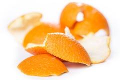 Peeled orange and its skin Stock Photos