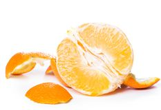 Peeled orange and its skin Royalty Free Stock Image