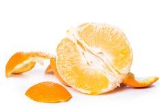 Peeled orange and its skin Royalty Free Stock Image