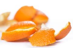 Peeled orange and its skin Royalty Free Stock Photo