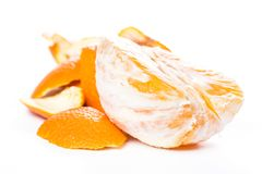 Peeled orange and its skin Stock Photos