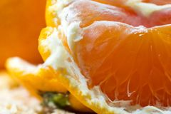 Close up macro peeled fresh orange fruit with orange pulps. stock photo