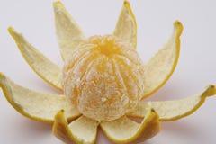Peeled orange. On white background Royalty Free Stock Image