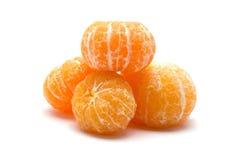 Peeled orange on white background Royalty Free Stock Images