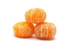 Peeled orange on white background Stock Images