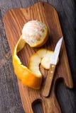 Peeled orange on wooden cutting board Stock Photos