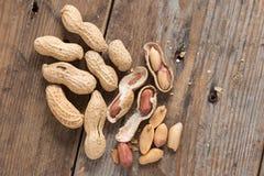 Peeled Peanut or arachis on wood background. Peeled Peanut or arachis on wood background Stock Photo