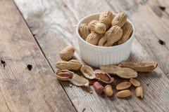 Peeled Peanut or arachis on wood table. Peeled Peanut or arachis on wood table Royalty Free Stock Photos