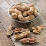 Peeled Peanut or arachis on wood table. Peeled Peanut or arachis on wood table Royalty Free Stock Image