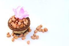Peeled peanut on small basket Royalty Free Stock Photo