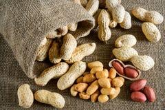 Peeled peanut on well peanuts Stock Photo