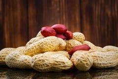 Peeled peanut on well peanuts Royalty Free Stock Photos