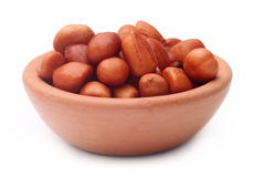 Peeled peanuts on a clay pot Royalty Free Stock Photos