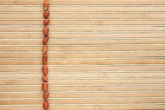 Peeled  peanuts  lying on a bamboo mat Stock Photography