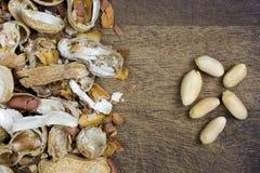 Peeled peanuts, nutshells Royalty Free Stock Images