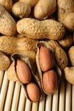 Peeled peanuts on well peanuts Royalty Free Stock Image