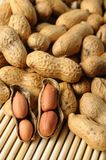 Peeled peanuts on well peanuts Stock Photos
