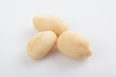 Peeled peanuts on white background Royalty Free Stock Images