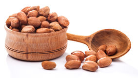 Peeled peanuts in a wooden bowl isolated Stock Image