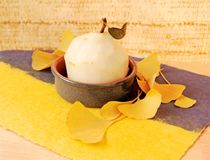 Peeled pear with ginkgo leaves Royalty Free Stock Image