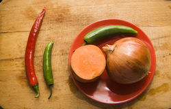 Peeled pepper and onion on board Royalty Free Stock Photos