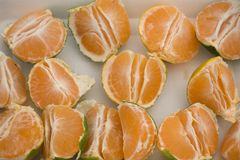 Peeled  and Pieced Green Mandarins on Table. In the Market Royalty Free Stock Image
