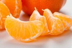 Peeled pieces of orange Stock Image