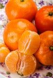 Peeled pieces of orange Stock Photography