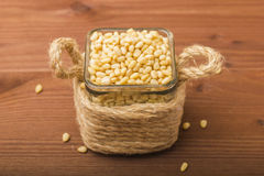 Peeled pine nuts in a glass bowl. Stock Image