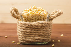 Peeled pine nuts in a glass bowl. Royalty Free Stock Photography