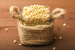 Peeled pine nuts in a glass bowl. Royalty Free Stock Image