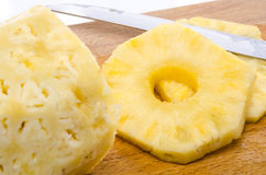 Peeled pineapple with slices Stock Photography